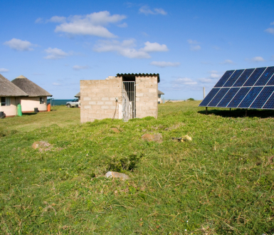 Solar panels providing power to a village in Africa. Shutterstock/Daleen Loest