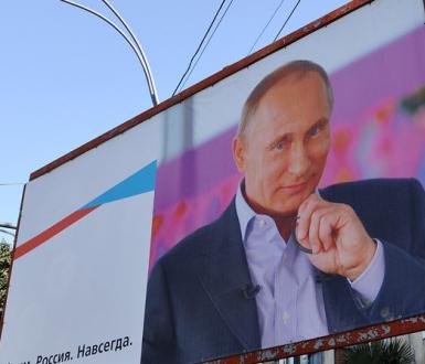 YALTA - MAR 07: Street billboard - Russia's President Vladimir Putin
