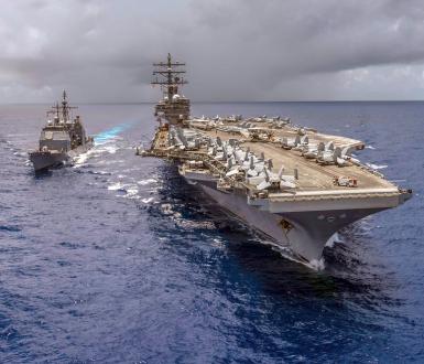 USS Antietam (CG 54) and USS Ronald Reagan (CVN 76) refuel at sea. (2018) © US Navy
