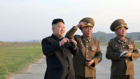 photo-d-archive-transmise-le-21-avril-2014-par-l-agence-kcna-via-kns-du-dirigeant-nord-coreen-kim-jong-un-assistant-a-un-entrainement-d-une-unite-de-l-armee-de-l-air-quelque-part-en-coree-du-nord_5400829.jpg