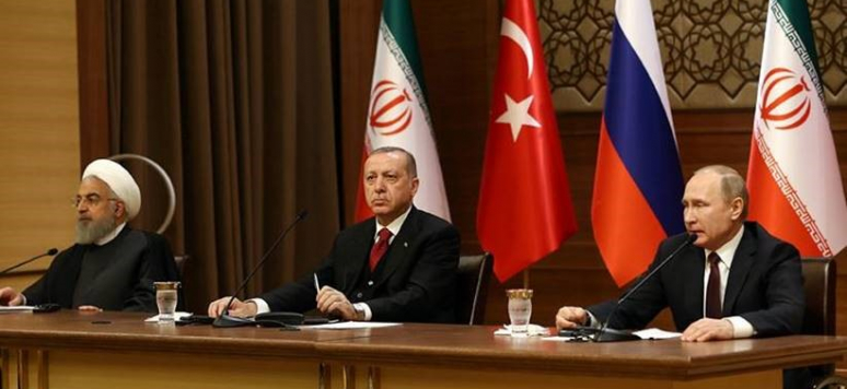 President Recep Tayyip Erdoğan, President of Russia Vladimir Putin and President of Iran Hassan Rouhani at the Presidential Complex in Ankara on April 4, 2018 for a trilateral summit.