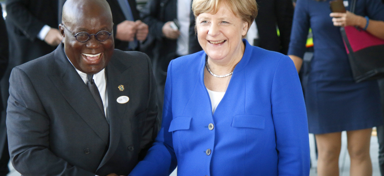Addo Dankwa Akufo-Addo and Angela Merkel shaking hands before a meeting of African leaders with the German Chancellor in Berlin.