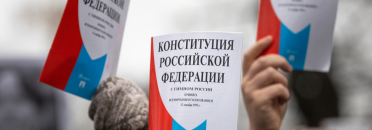 Moscow, Russia. 19th January, 2020. Opposition supporters hold a copy of Russia's constitution during a rally against constitutional reforms proposed by President Vladimir Putin in central Moscow