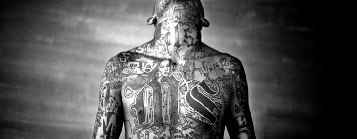 Chelatenango, El Salvador. May 2007. A members of the Mara Salvatrucha gang displays his tattoos inside the Chelatenango prison.