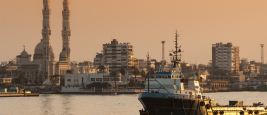 Port Said, Egypt, 2007 - The Offshore Supply Ship OSA Viscount passing north in the Suez Canal at sunset. BigRoloImages