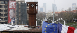 A huge Turkish President Recep Tayyip Erdogan's picture behind from European Union and France flag and Taksim Mosque minaret in Istanbul