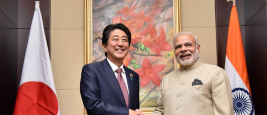 Shinzo Abe and Narendra Modi shaking hands at a Summit in September 2017.