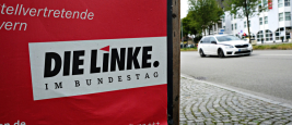 An election campaign poster of Die Linke party in street of Munich, Germany on July 23, 2017