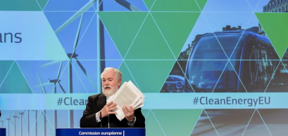EU climate commissioner Miguel Arias Cañete shows the new clean energy proposals at a press conference in Brussels.