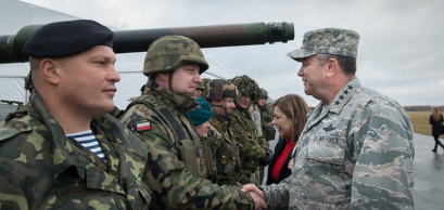 Gen. Philip Breedlove (centre) US Air Force, Supreme Allied Commander Europe, meets with a Polish soldier at the Ziemsko Airfield, Poland, during Exercise Steadfast Jazz on Nov. 7, 2013.