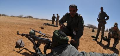 A Mauritanian soldier takes aim during basic rifle marksmanship training during Flintlock 2013.