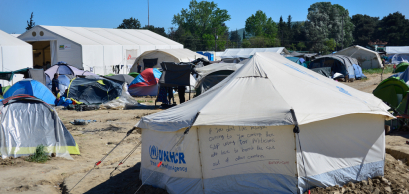 Idomeni/Greece. Inscription on the UNHCR tent in transit refugee/migrant camp
