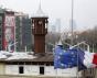 Une affiche d'Erdogan devant les drapeaux européen et français et le minaret de la mosquée de Taksim à Istanbul