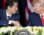 Donald Trump and Shinzo Abe signing their bilateral trade agreement on Sept. 25, 2019
